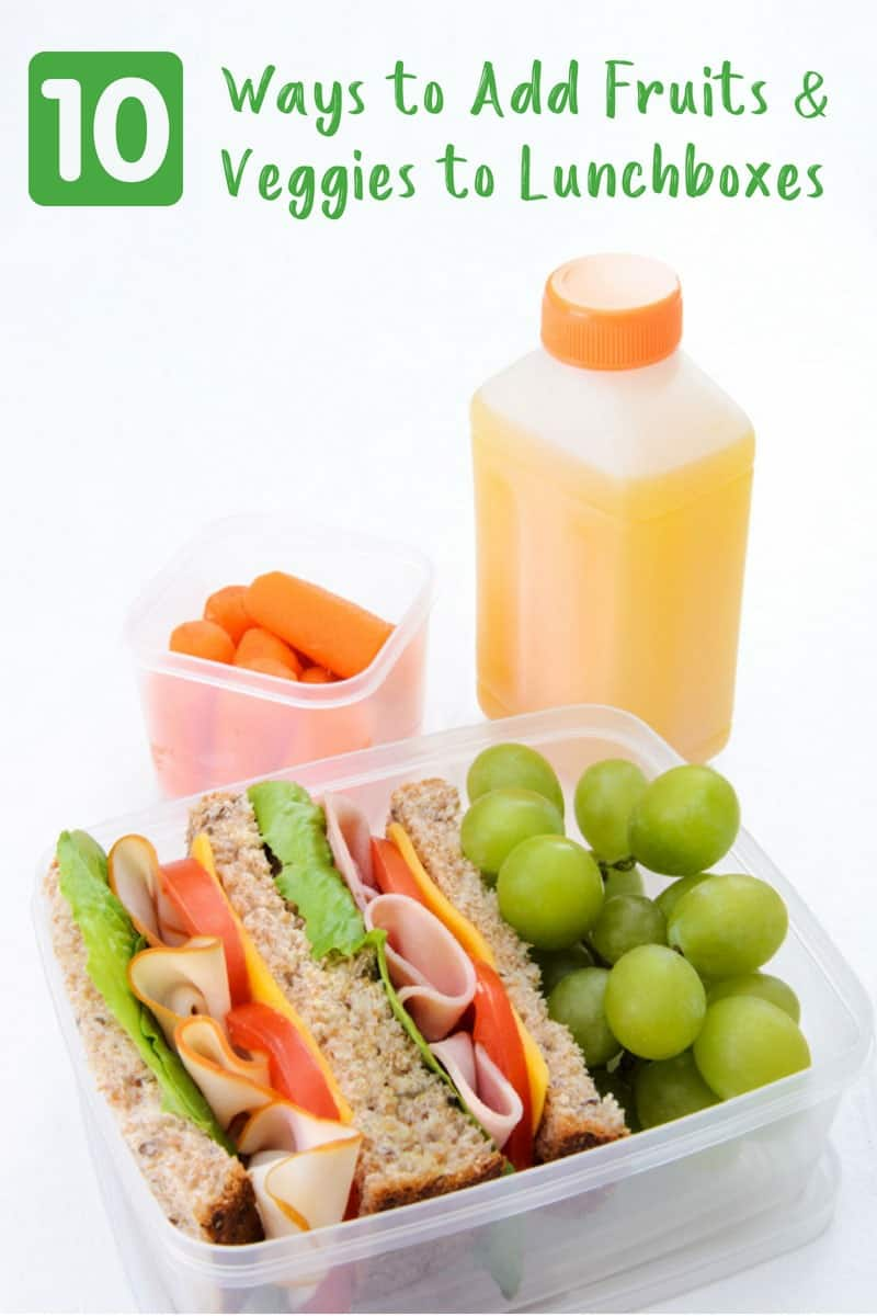 Lunchbox with sandwich, grapes, carrots and juice on white background